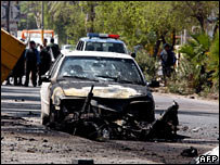 Police at the site of a car bomb attack in Baghdad on 26 September