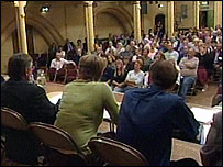 People at a public meeting