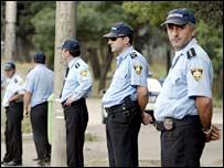 Georgian policemen surround Russia's military HQ in Tbilisi