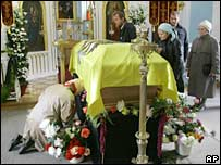 A woman bows as she mourns near the coffin containing the remains Empress Maria Fyodorovna in Peterhof, outside St Petersburg