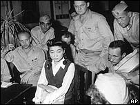 Iva Toguri D'Aquino being interviewed by US correspondents in Japan 1945