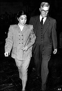 Iva Toguri D'Aquino being escorted from court in 1949