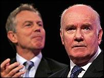 John Reid, applauded by Tony Blair