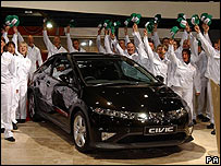 Employees from Honda's Swindon factory helping to unveil the new three door Honda Civic
