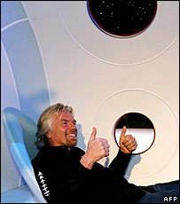 Virgin boss Richard Branson sitting in a passenger seat in the mock-up of SpaceShipTwo  Image: AFP