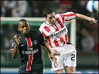 PSG's Kalou and Eddie McCallion of Derry City
