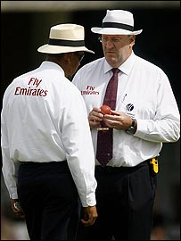 Umpires Billy Doctrove and Darrell Hair examine the ball