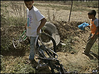 Boy pulls remains of bike from scene of bombing