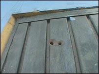 Bullet holes in a door