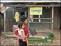 A shanty town shack with a sign protesting about evictions