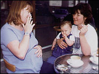 Pregnant woman and woman with child smoking