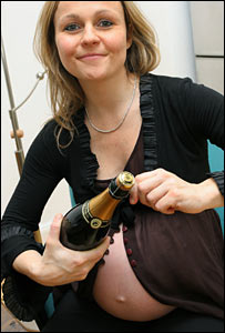 Pregnant woman opening bottle of champagne