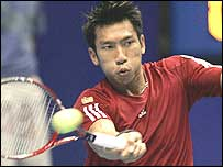 Paradorn Srichaphan plays a forehand against Tim Henman