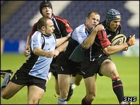 Simon Webster is halted by some last-ditch Glasgow defending