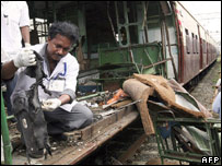 Forensic investigator at scene of one of the Mumbai train blasts