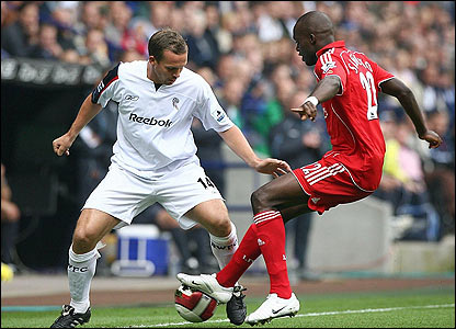 Bolton's Kevin Davies challenges Liverpool's Mohamed Sissoko