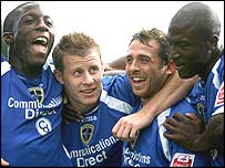 Paul Parry (second left) celebrates scoring Cardiff's fourth goal with Malvin Kamara, Michael Chopra and Kevin Campbell