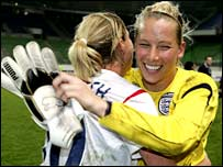 Kelly Smith (left) congratulates Rachel Brown after England's World Cup qualification