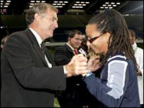FA director of development Sir Trevor Brooking congratulates England women coach Hope Powell