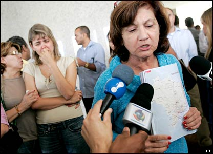 Relatives ask the media for information at a hotel in Brasilia