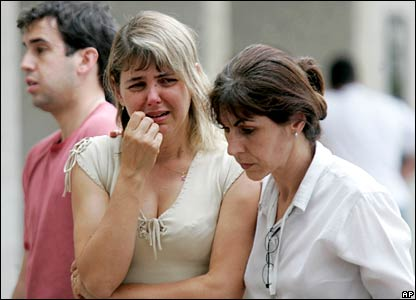 Relatives of victims cry at a hotel in Brasilia