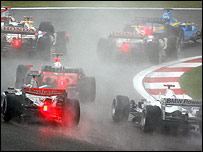 Formula One cars battle for superiority at the start of the Chinese Grand Prix