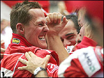 Michael Schumacher celebrates with the Ferrari team after winning the Chinese Grand Prix