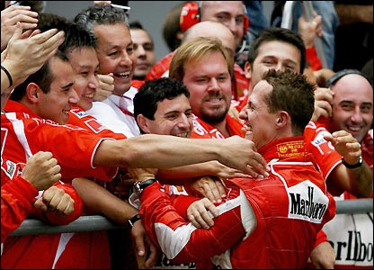 Schumacher embraces his pit crew