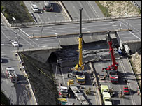 Rescuers at the collapsed overpass