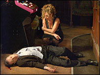 "A still from EastEnders where ""Dirty"" Den Watts was murdered by his girlfriend Chrissie"
