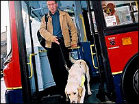 Blind man and dog exiting a bus