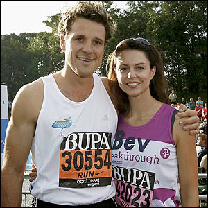 James Cracknell and his wife Beverley Turner pose at the start of the race