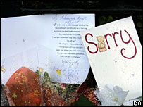 sorry card and flowers at church