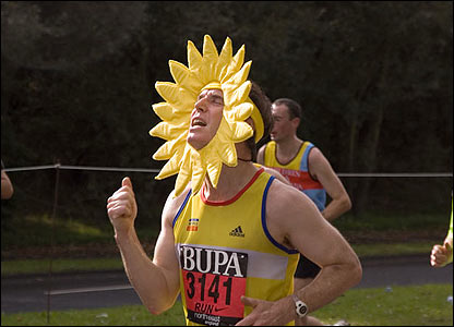A runner with sunflower head gear competes in the race