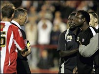 Leroy Rosenior (right) is sent to the stands by referee Clive Penton