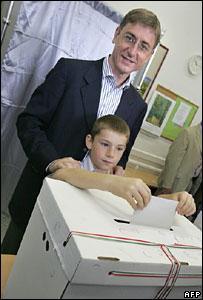 Hungarian PM Ferenc Gyurcsany votes in Budapest with his son Tamas