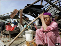 A woman cries in the rubble of her home in Danang, 1 October