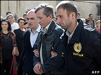 Georgian police escort one of the Russian officers to court (30 September)