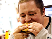 Man eating junk food (Science Photo Library)