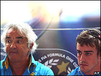 Renault team boss Flavio Briatore and Fernando Alonso at a news conference following Alonso's penalty at the Italian Grand Prix