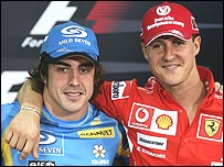 Fernando Alonso and Michael Schumacher pose for the cameras