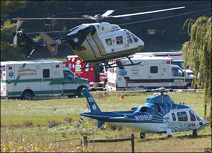 Ambulances and helicopters wait to transport victims to hospital