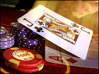 Playing card and betting chips