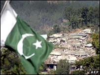 Pakistan flag flies over ruins of Balakot