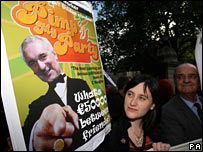 Protestors holding posters criticising Irish prime minister Bertie Ahern