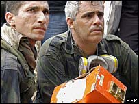 Rescuers with the Boeing's black box recorder