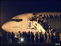 Passengers disembark from a hijacked aeroplane in Brindisi, Italy