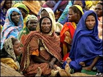Women sit in a makeshift camp in Seleah village, in Sudan's West Darfur province