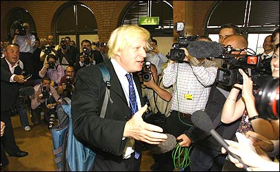Boris Johnson faces the media scrum