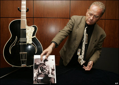 A guitar used by Elvis is shown by Doug Norwine, Director of Music and Entertainment Memorabilia